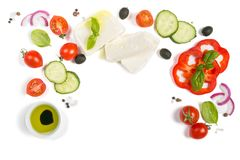 Healthy eating concept - selection of greek salad ingredients on white background. Top view Royalty Free Stock Image
