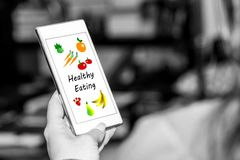 Healthy eating concept on a smartphone. Smartphone screen displaying a healthy eating concept royalty free stock images