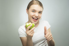 Healthy Eating Concept: Teenager Eating Apple Royalty Free Stock Image