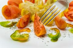 Tomatoes and fork royalty free stock photography