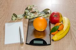 Healthy eating concept, weight loss with fruit on wooden table royalty free stock photo