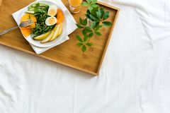 Healthy eating concept. Woman having breakfast in bed Royalty Free Stock Photography