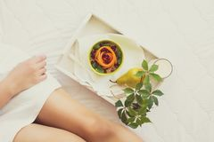 Healthy eating concept. Woman having breakfast in bed Stock Photos