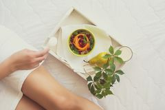 Healthy eating concept. Woman having breakfast in bed Royalty Free Stock Photo