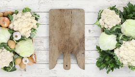 Healthy eating concept wooden cutting board with basket vegetabl Stock Photography