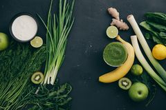 Healthy eating cooking green ingredients. Clean eating healthy cooking ingredients. Vegetables, beans, grains, greens, fruit, spices over grey marble background Royalty Free Stock Photos