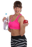 Healthy eating diet apple fruit drinking fitness fit slim woman Royalty Free Stock Images