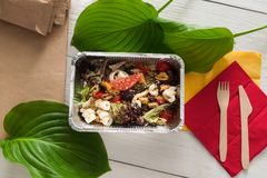 Healthy food in foil boxes, diet concept. Seafood salad Royalty Free Stock Image