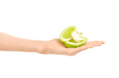 Healthy eating and diet Topic: Human hand holding half green pepper isolated on a white background in the studio. Shot stock image