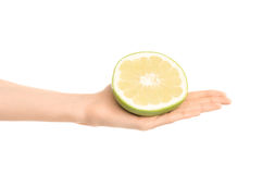 Healthy eating and diet Topic: Human hand holding a half sweetie isolated on white background in the studio Stock Images