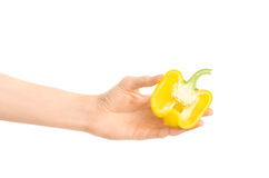 Healthy eating and diet Topic: Human hand holding a half of yellow pepper isolated on a white background in the studio Royalty Free Stock Images