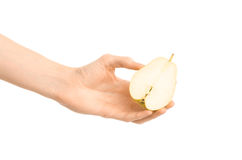 Healthy eating and diet Topic: Human hand holds half of pear isolated on a white background in the studio. Shot royalty free stock photography