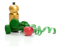 Healthy eating, diet and weight loss. dumbbells, apple  water Royalty Free Stock Photos