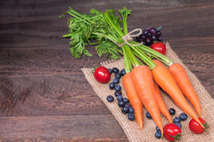 Healthy eating and dieting concept,fresh carrot and carrot juice or organic healthy juice in glass , tomato and blueberries Stock Photography
