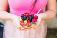 Healthy eating, dieting, vegetarian food and people concept - close up of woman hands holding berries outdoor.  Royalty Free Stock Photo