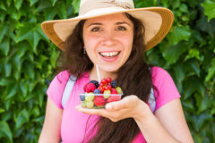 Healthy eating, dieting, vegetarian food and people concept - close up of woman hands holding berries outdoor.  Royalty Free Stock Photography