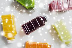 Bottles with different fruit or vegetable juices. Healthy eating, drinks, diet and detox concept - plastic bottles with different fruit or vegetable juices on Royalty Free Stock Image