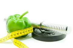 Healthy eating and exercise helps to lose weight Royalty Free Stock Photos