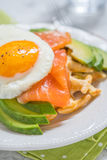 Healthy eating food breakfast oatmeal waffles, smoked salmon, avocado and egg stock images