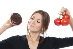 Healthy eating food concept woman donut tomatoes Stock Photo
