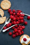 Raspberry and cookies. Healthy eating, food, dieting - oat cookies with  fresh raspberry soft cheese on black slate Royalty Free Stock Photography