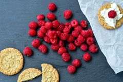 Raspberry and cookies. Healthy eating, food, dieting - oat cookies with  fresh raspberry soft cheese on black slate Stock Image