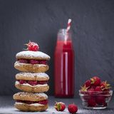 Oat cookies with raspberry, soft cheese, honey and raw raspberry and red juice on the background of black slate , close up Stock Photo