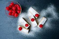 Raspberry pie. Healthy eating, food, dieting - pie  with  fresh raspberry soft cheese and  icing sugar, on   black background Royalty Free Stock Photography