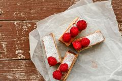 Raspberry pie. Healthy eating, food, dieting - pie  with  fresh raspberry soft cheese and  icing sugar, on   black background Royalty Free Stock Photo