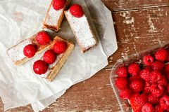 Raspberry pie. Healthy eating, food, dieting - pie  with  fresh raspberry soft cheese and  icing sugar, on    wooden background Royalty Free Stock Image