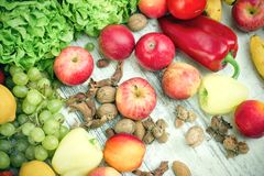 Healthy eating, healthy food - fresh organic fruits and vegetables. On white rustic table Royalty Free Stock Photo