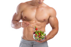 Healthy eating food salad bodybuilding bodybuilder body builder. Building muscles muscular young man isolated on a white background Royalty Free Stock Photo