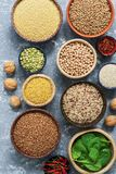 Healthy eating. Foods rich in protein, cereals, legumes, spinach. View from above. stock images