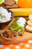 Healthy eating. Fresh fruit and dry loaves with curd Stock Photo