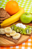 Healthy eating. Fresh fruit and dry loaves with curd Royalty Free Stock Photo