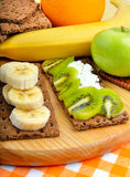 Healthy eating. Fresh fruit and dry loaves on a wooden backgroun Stock Images
