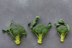 Fresh green broccoli on gray background, copy space, top view Stock Photo