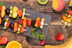 Healthy eating, fruit skewer. On wood stock images