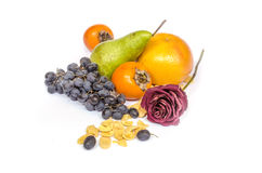 Healthy eating fruits cornflakes. The composition of healthy food, cornflakes, grapes, persimmon, pear, orange Stock Photo