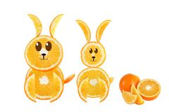 Healthy eating. Funny couple of rabbit made of the orange slices Royalty Free Stock Image
