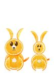Healthy eating. Funny couple of rabbit made of the orange slices. On white Stock Photography