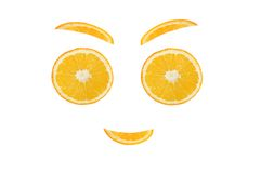 Healthy eating. Funny face made of the orange slices.  Royalty Free Stock Image
