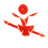 Healthy eating. Funny little danser made of the grapefruit slice Stock Photos