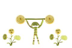 Healthy eating. Funny little man of the kiwi slices Royalty Free Stock Images