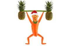 Healthy eating. Funny little man  raises bar.  Happy New Year. Royalty Free Stock Photo