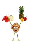 Healthy eating. Funny little man of the walnut raises fruit and Royalty Free Stock Photos