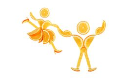 Healthy eating. Funny little pair of dancers. Healthy eating. Funny little pair made of the orange slices Stock Image