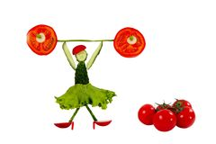 Healthy eating. Funny little woman of the cucumber slices Stock Photos