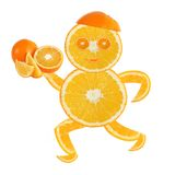 Healthy eating. Funny running little man made of the orange sli Royalty Free Stock Images