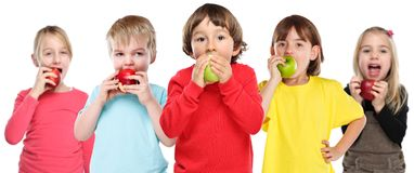 Healthy eating group of kids children apple fruit isolated on white. Healthy eating group of kids children apple fruit isolated on a white background royalty free stock photo